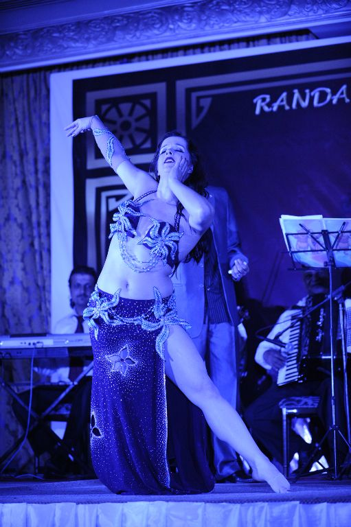 Randa Kamel of Course - purple and turquoise Hisham Osman costume